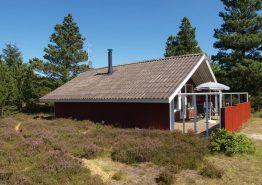 Beschauliches Holzhaus mit geschlossener Terrasse (Bild 1)