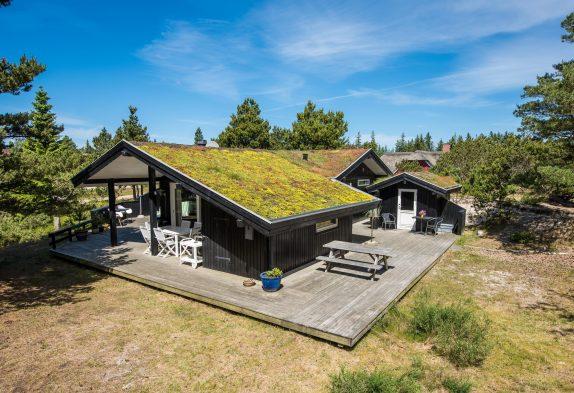 Einladendes Holzferienhaus mit 3 Terrassen und Sauna