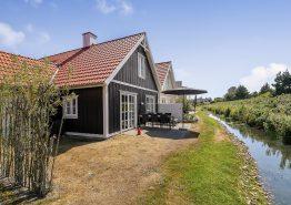 Hyggeligt og centralt sommerhus med sauna og spa