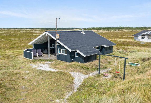 Sommerhus med overdækket terrasse og gratis internet