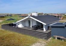 Feriehus med sauna og lukket terrrasse nær stranden