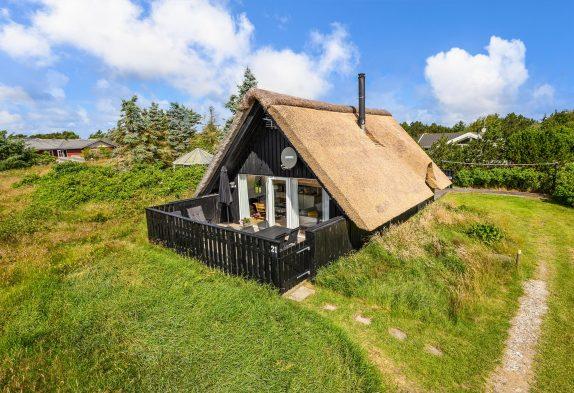 Ferienhaus geschlossener Terrasse und einem Gartenpavillion