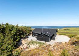 Lækkert feriehus med sauna, spa og fantastisk udsigt til fjorden (billede 1)