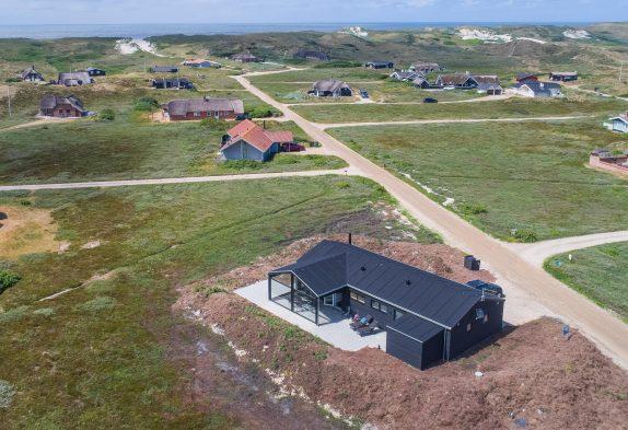 Femstjernet feriehus med spa, sauna og strandnær beliggenhed