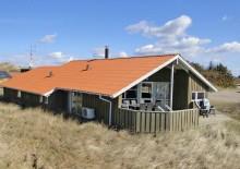 Velbeliggende sommerhus med sauna på Mettes Bjerg