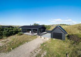 Sommerhaus in ruhiger Lage mit überdachter Terrasse (Bild 1)