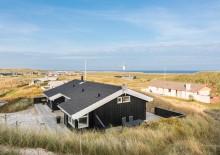Hus på klitgrund med en flot udsigt og en skøn terrasse. Kat. nr.:  E4396, Tingodden 507;