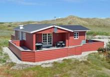 Ferienhaus mit Terrasse auf schönem Naturgrundstück