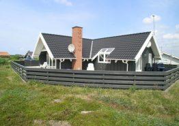 Ferienhaus mit geschlossener Terrasse nah am Leuchtturm