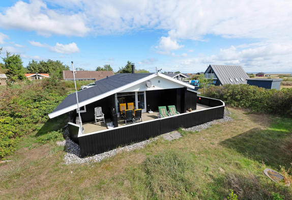 Ferienhaus mit geschlossener Terrasse und Kaminofen
