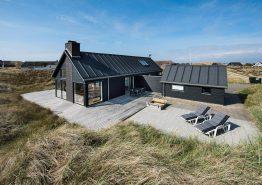 Ferienhaus mit windgeschützten Plätzen auf der Terrasse (Bild 1)