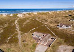 Poolhaus mit Panoramablick auf die Dünenlandschaft