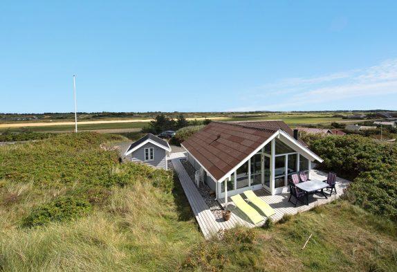 Ferienhaus mit Aussicht auf die Dünen & Hund erlaubt