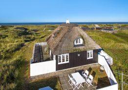 Wunderschönes Holzhaus in unmittelbarer Strandnähe