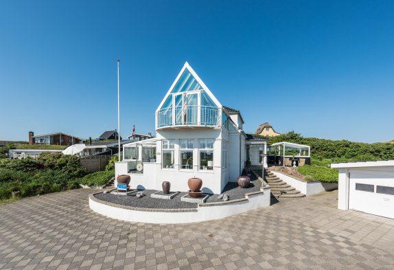 Smagfuld indrettet kvalitetshus i Søndervig med udestue