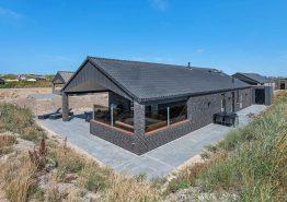 Luksuriøst feriehus i Søndervig med udespa, sauna og gratis strøm