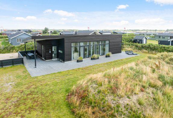 Fünf-Sterne-Ferienhaus mit Sauna und toller Terrasse – nur 300 Meter bis zum Meer